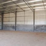 Large Workshop Shed With Concrete Walls Interior